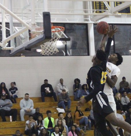 Forte Prater dunks on a defender during the game against Greenville