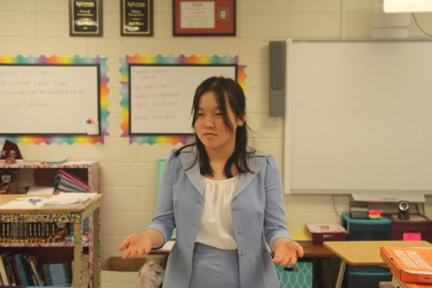 Jessica Yan practices for her duo interpretation performance at the speech and debate competition.