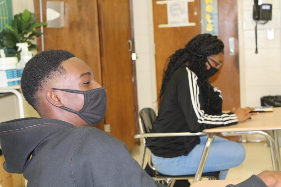 Students wear masks during Algebra I.