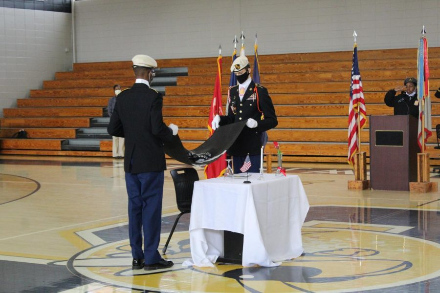 JROTC+cadets+set+the+table+to+honor+MIA+soldiers.