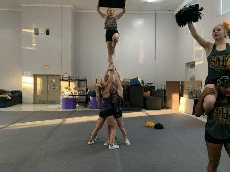 SHS Cheerleaders work on stunts at cheer practice.