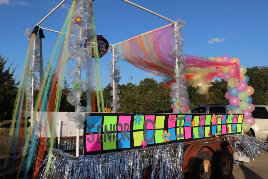 The senior class float is disco themed in the homecoming parade.