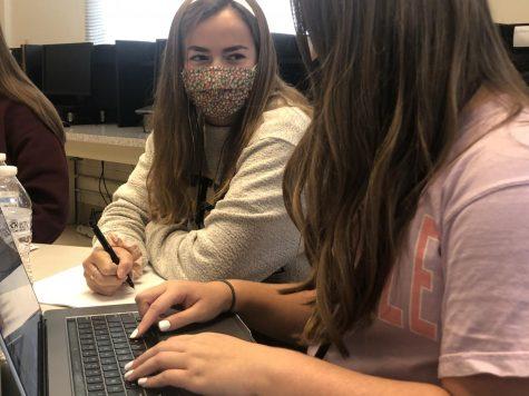 Amanda Kaplan tutors Neely Wells during after-school tutoring.