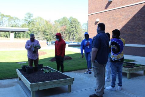 Coach Carlisle teaches students about the Horticulture program.