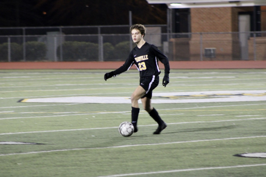 Senior Mckee Mulrooney drives down the field.