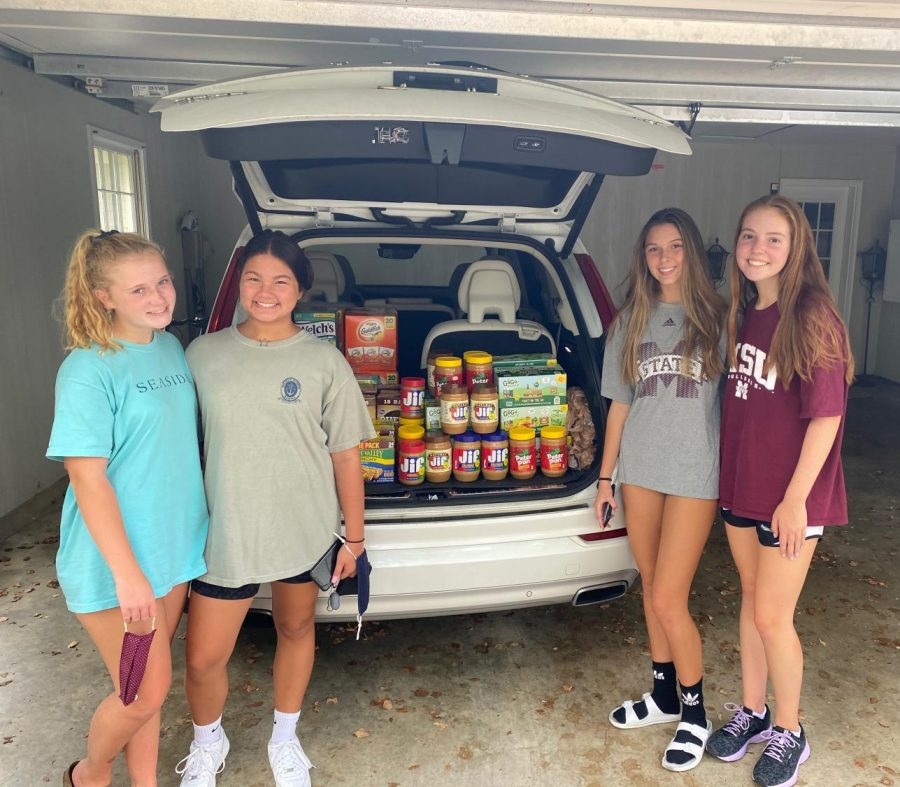 Sophomores Anna Potts, Sophie Butler, Harper Ford, and Katie Randall pose with the donations collected.