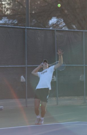 Sophomore Luca Hoffman serves the ball.