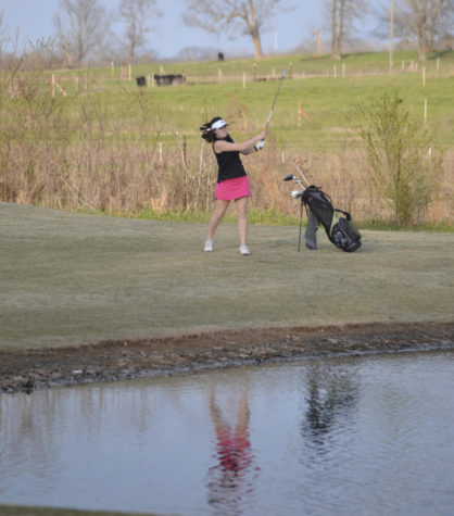 Anna Richey chips over the hazard on hole five.