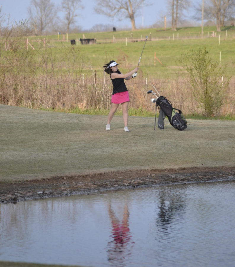 Anna+Richey+chips+over+the+hazard+on+hole+five.