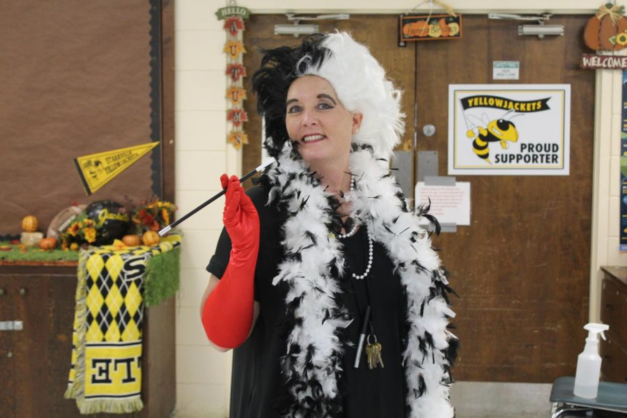 Kathy Dawkins, marketing teacher, supports the CAB House as Cruella De Vil on Hero vs Villain day.